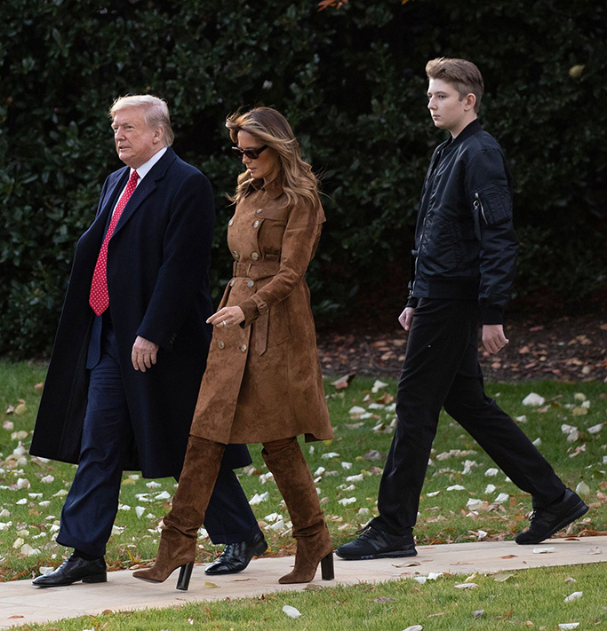US President Donald Trump (L), First Lady Melania Trump (C) and their son Barron Trump (R) walk outside the West Wing to depart the South Lawn by Marine One, at the White House in Washington, DC, USA, 26 November 2019. President Trump and the First Lady depart for Florida where they will spend the Thanksgiving holiday.US President Donald J. Trump and First Lady Melania Trump depart the White House, Washington, USA - 26 Nov 2019