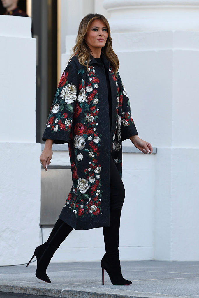 dolce gabbana coat, dg coat, christian louboutin boots, First lady Melania Trump walks out to take delivery of the 2019 White House Christmas tree as it arrives at the White House in Washington, . The Douglas fir is approximately 23 feet tall and was grown by Larry and Joanne Snyder at Mahantongo Valley Farms in Pennsylvania. Since 1966, the National Christmas Tree Association has held a contest that awards its winner with the honor of presenting their tree to the first family and will serve as a centerpiece for Christmas decorations in the Blue Room of the White HouseTrump Christmas Tree, Washington, USA - 25 Nov 2019