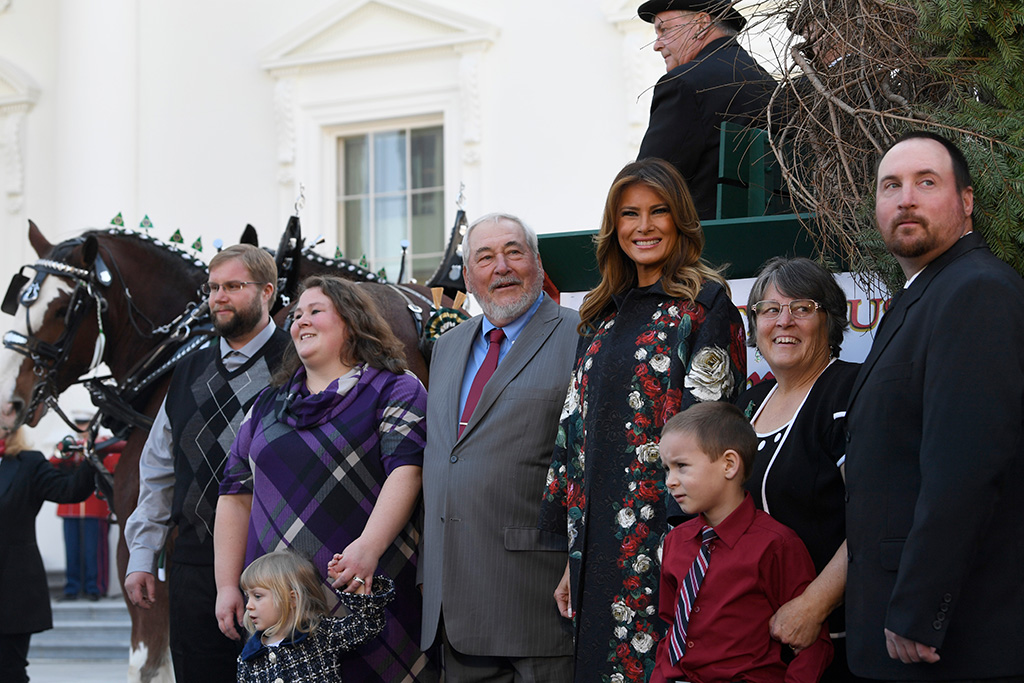 dolce gabbana coat, dg coat, christian louboutin boots, Melania Trump, Larry Snyder. First lady Melania Trump poses with the 2019 White House Christmas tree as it is delivered to the White House in Washington, . The Douglas fir is approximately 23 feet tall and was grown by Larry Snyder, third from left, at Mahantongo Valley Farms in Pennsylvania. Since 1966, the National Christmas Tree Association has held a contest that awards its winner with the honor of presenting their tree to the first family and will serve as a centerpiece for Christmas decorations in the Blue Room of the White HouseTrump Christmas Tree, Washington, USA - 25 Nov 2019