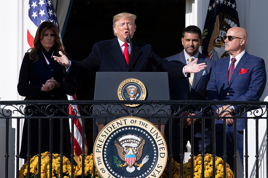 US President Donald J. Trump (C) gestures beside Nationals manager Dave Martinez (2-R), Nationals general manager Mike Rizzo (R) and US First Lady Melania Trump (L) during an event welcoming the 2019 World Series Champions, The Washington Nationals, at the South Portico of the White House in Washington, DC, USA, 04 November 2019. The Washington Nationals defeated the Houston Astros to win the 2019 World Series, bringing home the first baseball title for the city since the Washington Senators won in 1924.US President Donald J. Trump welcomes the 2019 World Series Champions, The Washington Nationals, USA - 04 Nov 2019