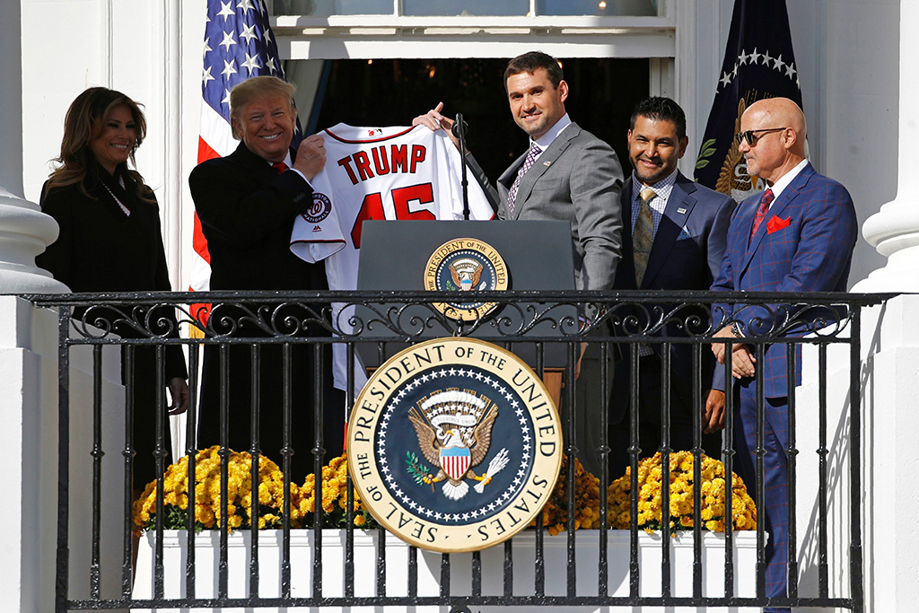 Ryan Zimmerman, Donald Trump, Dave Martinez, Mike Rizzo, Melania Trump. Washington Nationals first baseman Ryan Zimmerman, center, presents a jersey to President Donald Trump during an event to honor the 2019 World Series champion Nationals baseball team at the White House, in Washington. Standing alongside are first lady Melania Trump, left, manager Dave Martinez, second from right, and general manager Mike RizzoTrump, Washington, USA - 04 Nov 2019