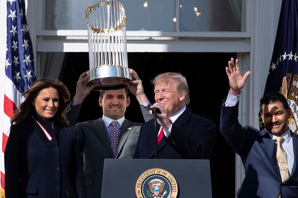 US President Donald J. Trump (C) and First Lady Melania Trump (L) stand beside Washington Nationals pitcher Ryan Zimmerman (2-L) holding the Commissioner's Trophy and Nationals manager Dave Martinez (R); during an event welcoming the 2019 World Series Champions, The Washington Nationals, at the South Portico of the White House in Washington, DC, USA, 04 November 2019. The Washington Nationals defeated the Houston Astros to win the 2019 World Series, bringing home the first baseball title for the city since the Washington Senators won in 1924.US President Donald J. Trump welcomes the 2019 World Series Champions, The Washington Nationals, USA - 04 Nov 2019