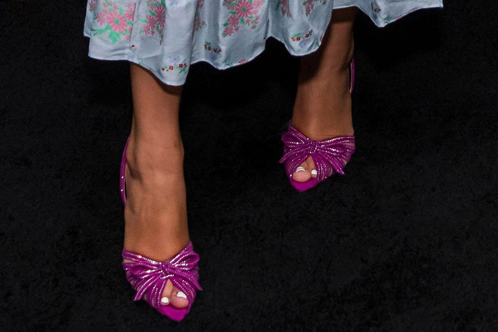 "Millie Bobby Brown, pedicure, peep-toe pumps, shoe style, markarian, skirt, shirt, spring 2020, celebrity style, christian louboutin shoes, sandals, magenta sandals, crystal embellished heels, attends a special screening of Netflix's ""Stranger Things,"" Season 3 at the DGA New York Theater, in New YorkNY Special Screening of Netflix's ""Stranger Things"" Season 3, New York, USA - 11 Nov 2019"
