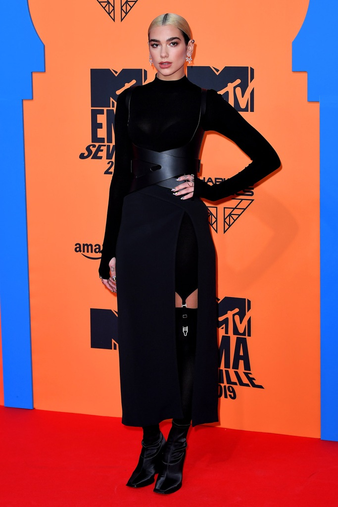 Dua Lipa, dion lee spring 2020, black dress, stockings, garters, jimmy choo boots, square toes, celebrity style, red carpet, mtv european music awards, emas, 26th MTV EMA, Arrivals, Seville, Spain - 03 Nov 2019Wearing Dion Lee Same Outfit as catwalk model *10407034ap