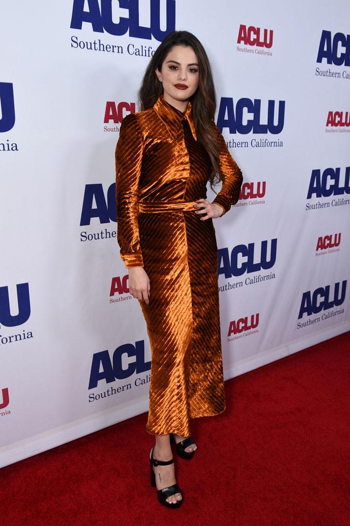 Selena Gomez, Prada, orange dress, black sandals, platform shoes, red carpet, celebrity style, aclu bill of rights dinner, foot tattoo, los angeles