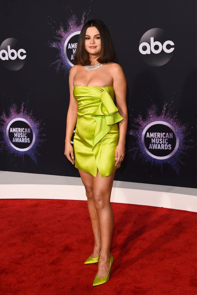 Selena Gomez, versace, roberto coin jewelry, neon green, minidress, pumps, stilettos, legs, 47th Annual American Music Awards, Arrivals, Microsoft Theater, Los Angeles, USA - 24 Nov 2019Selena Gomez 47th Annual American Music Awards, Arrivals, Microsoft Theater, Los Angeles, USA - 24 Nov 2019