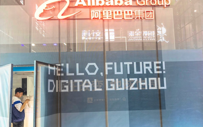 A man stands at the Alibaba Group booth during Big Data Expo in Guiyang, Guizhou province, China, 26 May 2019. The expo on big data opened on 26 May, incudes major Chinese companies and focuses on the latest innovations in technology and its applications. Guizhou province set up China's first big data pilot zone which has attracted companies such as Apple, Qualcomm, Huawei, Tencent, Alibaba and Foxconn.Big Data Expo in Guiyang, China - 26 May 2019
