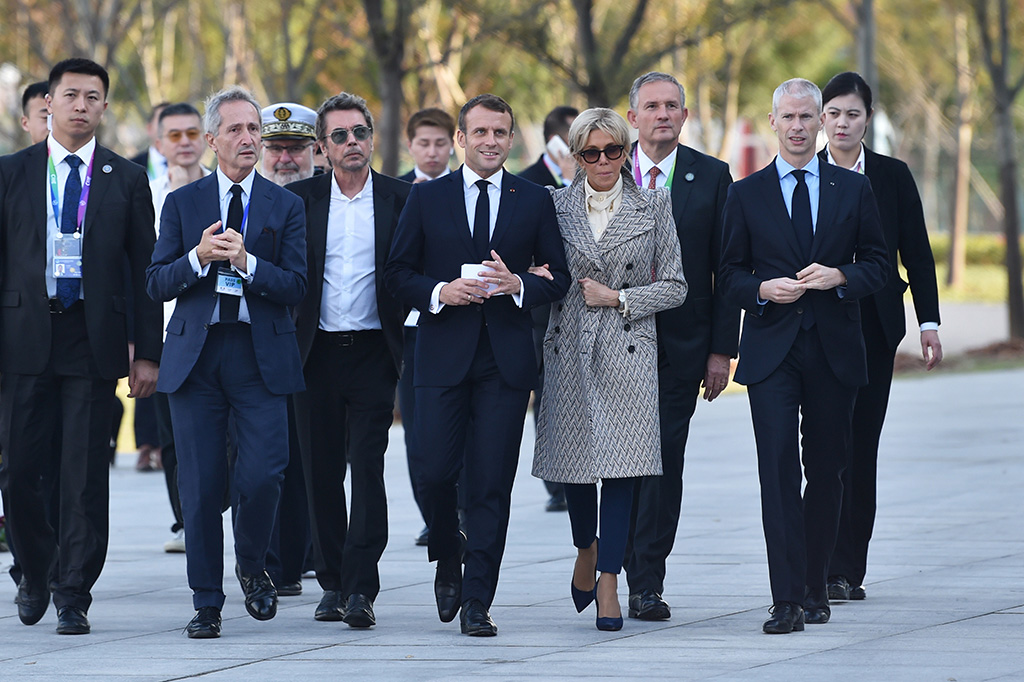 brigitte macron, chevron print coat, navy pants, suede pumps, stilettos, celebrity style, French President Emmanuel Macron (C-L), First Lady Brigitte Macron (C-R), French composer Jean-Michel Jarre (3-L) and French Minister of Culture Frank Riester (R) arrive to the inauguration of the Centre Pompidou West Bund Museum in Shanghai, China, 05 November 2019.French President Emmanuel Macron visits China, Shanghai - 05 Nov 2019