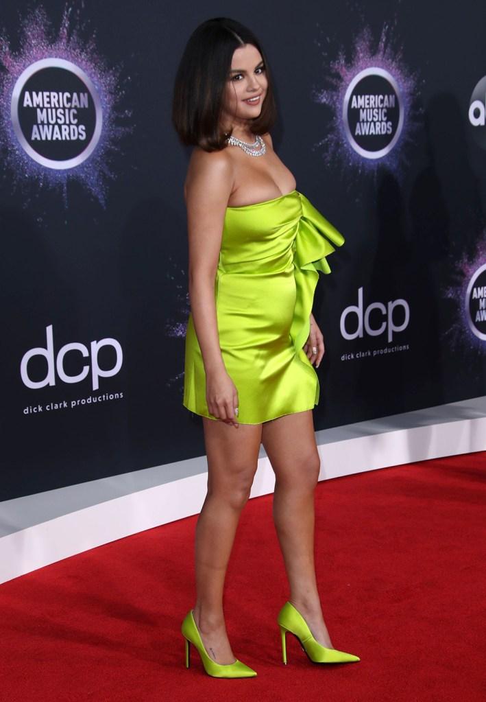 Selena Gomez, versace, roberto coin jewelry, neon green, minidress, pumps, stilettos, legs, 47th Annual American Music Awards, Arrivals, Microsoft Theater, Los Angeles, USA - 24 Nov 2019