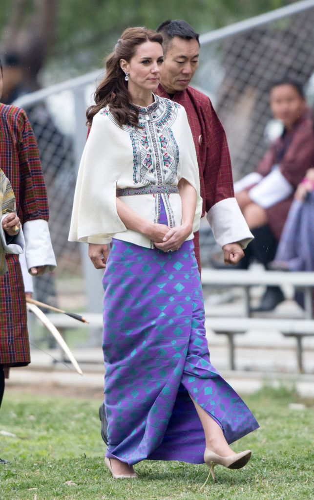 kate middleton, lk bennett floret, nude pumps, stilettos, Catherine Duchess of Cambridge at the open-air archery venue, ThimphuPrince William and Catherine Duchess of Cambridge visit to Bhutan - 14 Apr 2016Thimphu's open-air archery venue, located in the heart of the small city. Their Royal Highnesses will see first-hand Bhutan's awe-inspiring national sport, where archers must aim at very small, brightly decorated wooden targets positioned 145 metres away from where they are standing. The Duke and Duchess will also have the opportunity to meet young people from local schools and NGOs and see other traditional games WEARING PAUL & JOE (CAPE TOP)
