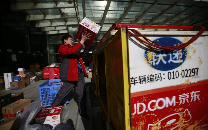 A Chinese 'kuadi' or delivery man move packages into his three-wheel delivery cart at a distribution centre for JD.com on Singles Day, otherwise known as '11.11' Global Shopping Festival, in Beijing, China, 11 November 2017. Singles Day is the largest online shopping festival in the world and Chinese consumers are expected to spend billions on bargains during the one-day e-commerce shopping spree.Singles Day or 11.11 Global Shopping Festival, Beijing, China - 11 Nov 2017