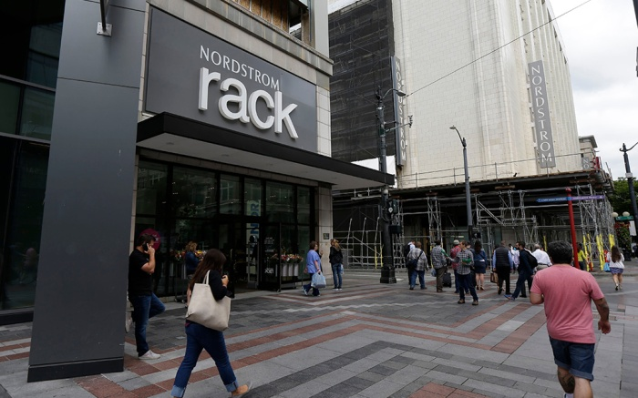 Pedestrians walk past an entrance for a Nordstrom Rack store next to the retailer's flagship store in downtown SeattleNordstrom, Seattle, USA - 13 Sep 2017