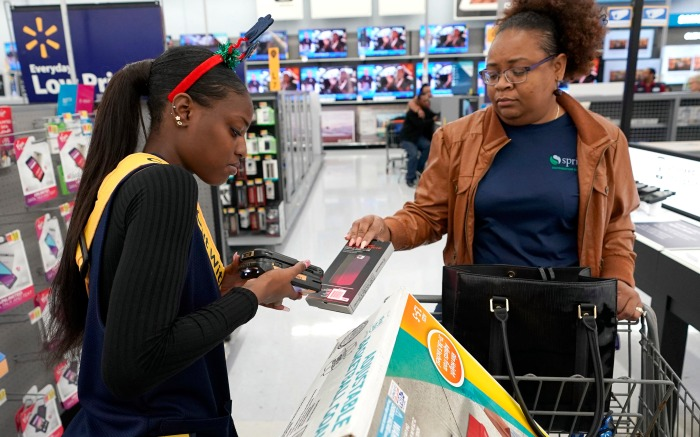 "Walmart, Shanay Bishop, Carolyn Sarpy, Check out with me. Walmart associate Shanay Bishop, left, checks out customer Carolyn Sarpy on the sales floor as part of the ""Check Out With Me"" program at a Walmart Supercenter in Houston. Walmart, Target and other large retailers are sending workers throughout their stores to check customers out with mobile devices. And at Macy's, shoppers can scan and pay for items on their own smartphonesFast Checkout-Holiday, Houston, USA - 09 Nov 2018"