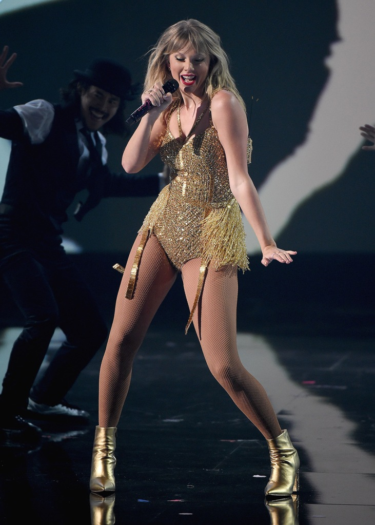 Taylor Swift, marc fisher ltd shoes, gold ankle boots, gold bodysuit, fishnet tights, legs, celebrity style, blonde, 47th Annual American Music Awards, Show, Microsoft Theater, Los Angeles, USA - 24 Nov 2019