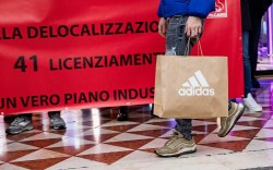 Adidas employees in Milan stage a