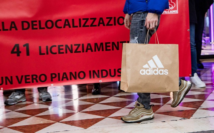 Adidas employees in Milan stage a protest over dismissals, Dec. 18 2019