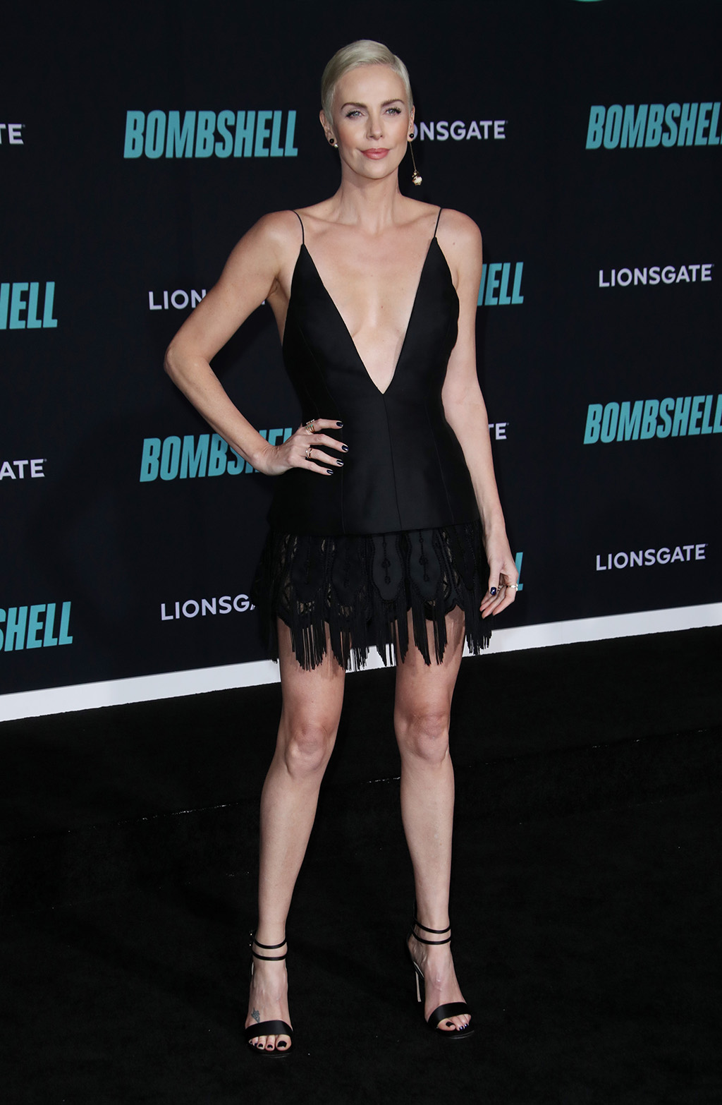 Charlize Theron, dior, minidress, low cut dress, cleavage, sandals, 'Bombshell' film premiere, Arrivals, Regency Village Theatre, Los Angeles, USA - 10 Dec 2019Wearing Dior Same Outfit as catwalk model *10325126ai