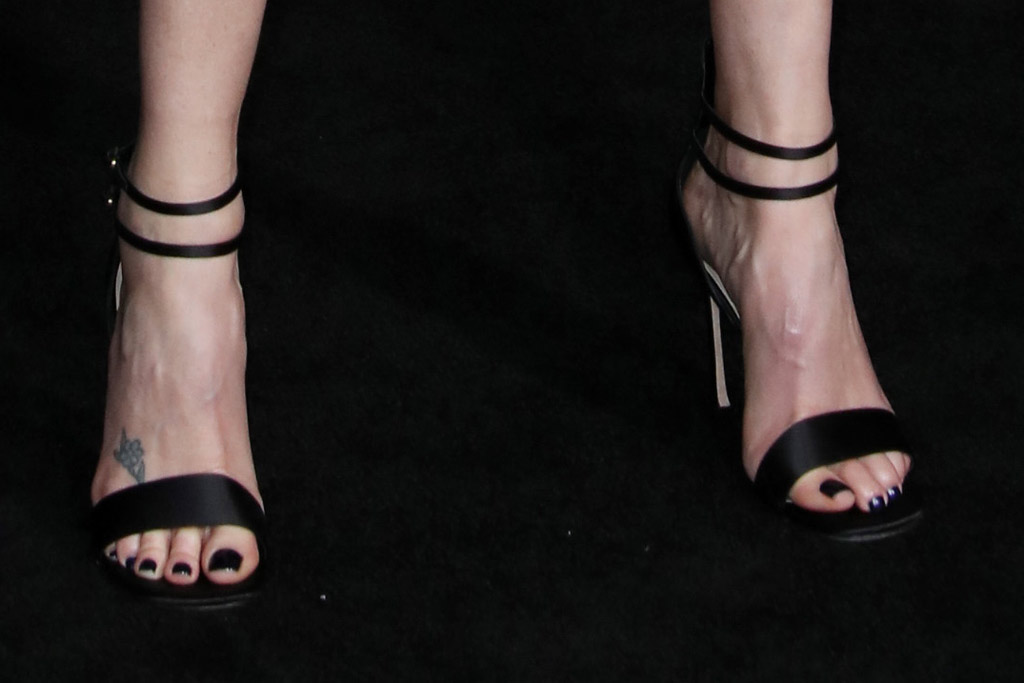 Charlize Theron, bombshell premiere, sandals, black nail polish, toes, shoe style, red carpet, foot tattoo