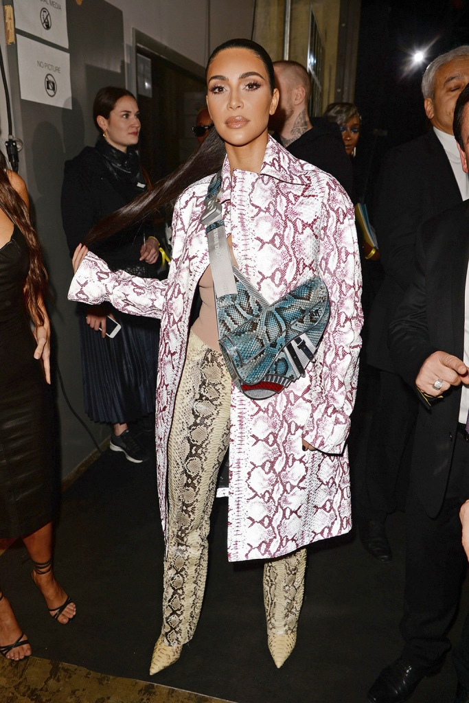 Kim Kardashian , celebrity style, dior mens coat, yeezy boots, gucci pants, dior saddle bag, snake print, WestDior Men's Show, Backstage, Pre-Fall 2020, Miami, USA - 03 Dec 2019Wearing Dior Men Same Outfit as catwalk model *10490783cn, Coat, Wearing Gucci, Trousers, Shoes By Yeezy, Bag By Dior
