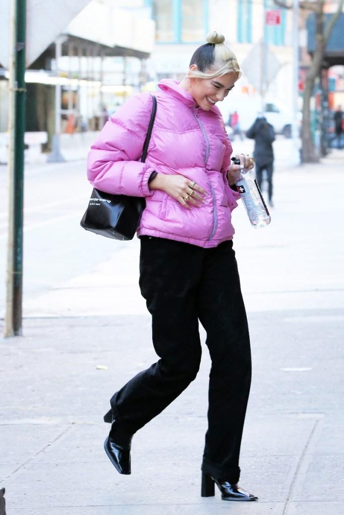 dua lipa, anwar hadid, pink jacket, puffer, black boots