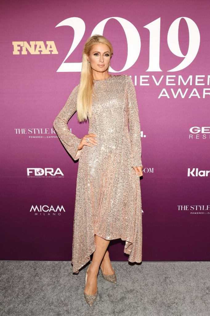 paris Hilton, FNAA, gold dress, gold pumps, celebrity style, blonde, on the red carpet for the 2019 FNAAs, red carpet, FNAAs, footwear news achievement awards, fnaa