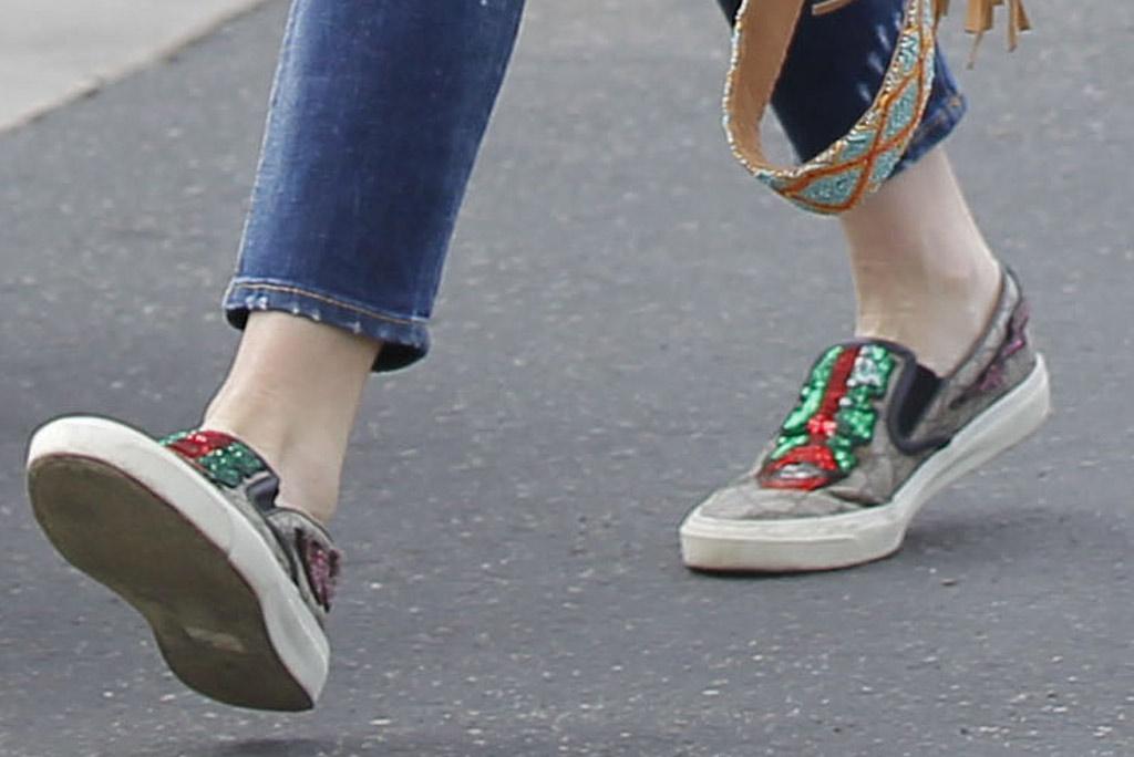 Gwen Stefani, Gucci sneakers, slip-on shoes, skinny jeans, los angeles, december 2019