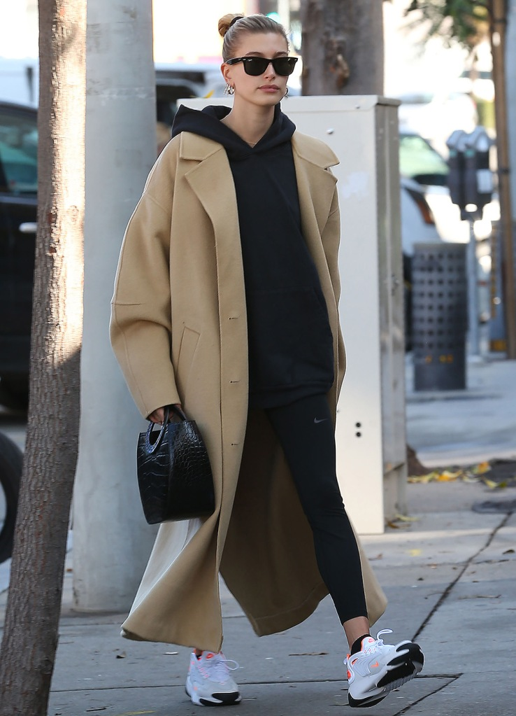 Hailey Bieber, hailey baldwin, beige coat, nike leggings, hoodie, nike zoom tk, white sneakers, chunky sneakers, retro sneakers, celebrity style, ray-bans, Hailey Bieber out and about in Los Angeles, USA - 09 Dec 2019Wearing Nanushka, Coat, staud handbag,