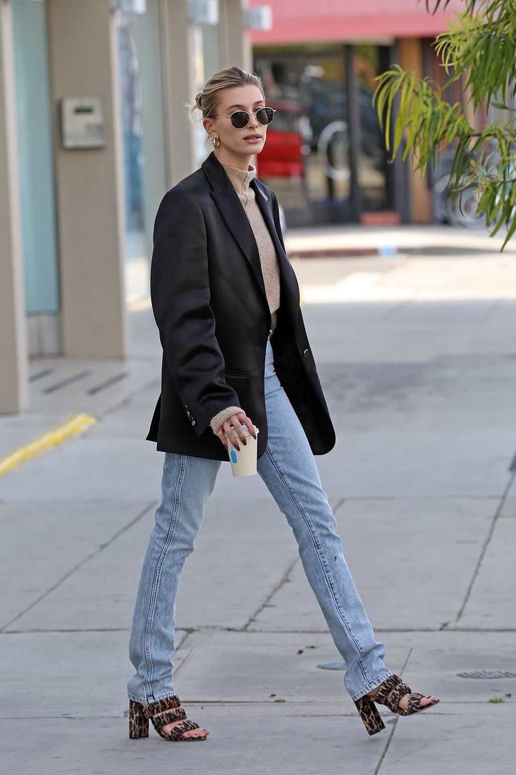 hailey baldwin, krewe sunglasses, jil sander shirt, off-white blazer, khaite jeans, chloe gosselin shoes, leopard print sandals, jennifer fisher hoops, blond hair, Hailey Bieber looks sophisticated while grabbing a coffee. 17 Dec 2019 Pictured: Hailey Bieber. Photo credit: Rachpoot/MEGA TheMegaAgency.com +1 888 505 6342 (Mega Agency TagID: MEGA570760_004.jpg) [Photo via Mega Agency]