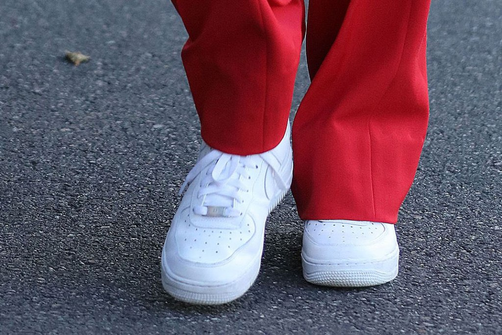 Hailey Baldwin, balenciaga pantsuit, red pants, nike air force 1, sneakers, white shoes, celebrity style, los angeles, december 2019