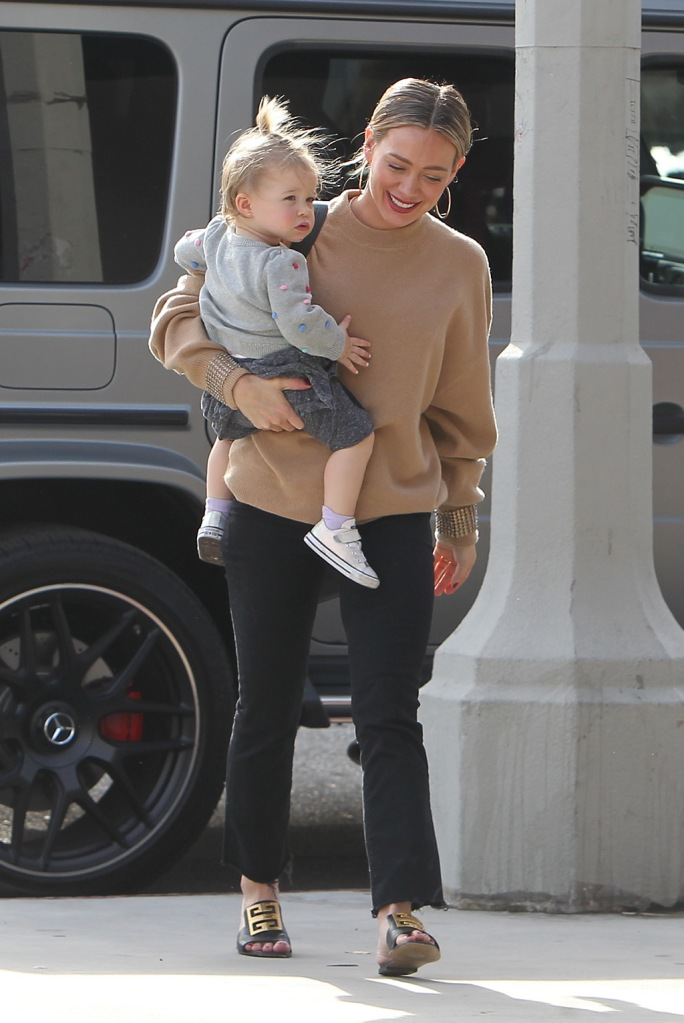 Hilary Duff , alexander wang sweater, beige sweater, black pants, givenchy shoes, sandals, shows off her wedding ring while visiting friends a day after she married Mathew Koma in a small ceremony at their home in Los AngelesPictured: Ref: SPL5137089 221219 NON-EXCLUSIVEPicture by: SplashNews.comSplash News and PicturesLos Angeles: 310-821-2666New York: 212-619-2666London: +44 (0)20 7644 7656Berlin: +49 175 3764 166photodesk@splashnews.comWorld Rights