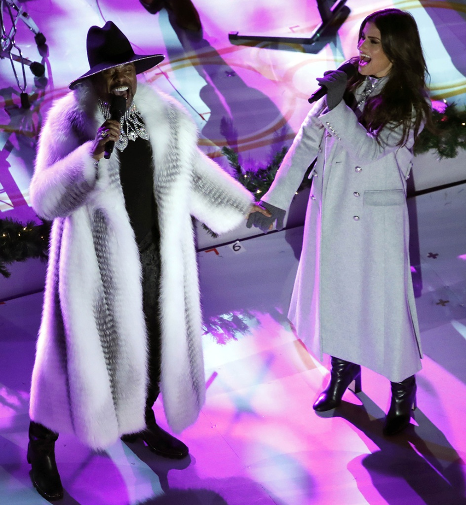 Billy Porter, fur coat, fox fur, helen yarmak, coat, black boots, black hat, (L) and Idina Menzel (R) perform in front of The Rockefeller Center Christmas Tree during the 87th annual tree lighting ceremony at the Rockefeller Center in New York, USA, 04 December 2019.Annual Rockefeller Center Christmas tree lighting ceremony in New York, USA - 04 Dec 2019