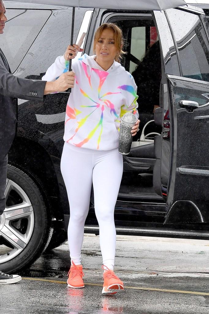 Jennifer Lopez, j-lo, workout, nike sneakers, orange sneakers, nike shoes, celebrity style, tie-dye sweatshirt, myrrhe hoodie, leggings, gym run in the Miami rainPictured: Jennifer LopezRef: SPL5136753 191219 NON-EXCLUSIVEPicture by: Robert O'Neil / SplashNews.comSplash News and PicturesLos Angeles: 310-821-2666New York: 212-619-2666London: +44 (0)20 7644 7656Berlin: +49 175 3764 166photodesk@splashnews.comWorld Rights
