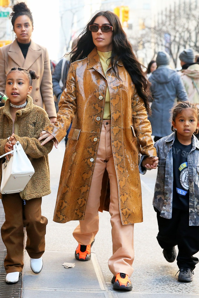kim kardashian, yeezy sneakers, adidas yeezy boost 700 mnvn, snakeprint coat, salmon pants, yellow shirt, north west, brown pants, fleece, white boots, bag, TV personality Kim Kardashian gets in some last minute Christmas shopping with North West and Saint West at Saks Fifth Avenue in New York City. Kim is seen wearing a snakeskin coat, yellow top, light orange leather pants and orange shoes.Pictured: Kim KardshianRef: SPL5137109 221219 NON-EXCLUSIVEPicture by: Christopher Peterson / SplashNews.comSplash News and PicturesLos Angeles: 310-821-2666New York: 212-619-2666London: +44 (0)20 7644 7656Berlin: +49 175 3764 166photodesk@splashnews.comWorld Rights