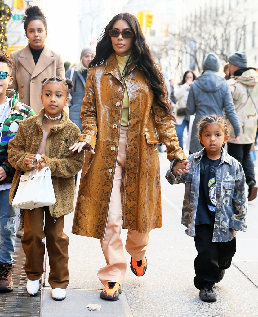 kim kardashian, yeezy sneakers, adidas yeezy boost 700 mnvn, snakeprint coat, salmon pants, yellow shirt, north west, brown pants, fleece, white boots, bag, TV personality Kim Kardashian gets in some last minute Christmas shopping with North West and Saint West at Saks Fifth Avenue in New York City. Kim is seen wearing a snakeskin coat, yellow top, light orange leather pants and orange shoes.Pictured: Kim KardshianRef: SPL5137109 221219 NON-EXCLUSIVEPicture by: Christopher Peterson / SplashNews.comSplash News and PicturesLos Angeles: 310-821-2666New York: 212-619-2666London: +44 (0)20 7644 7656Berlin: +49 175 3764 166photodesk@splashnews.comWorld RightsTV personality Kim Kardashian gets in some last minute Christmas shopping with North West and Saint West at Saks Fifth Avenue in New York City. Kim is seen wearing a snakeskin coat, yellow top, light orange leather pants and orange shoes.Pictured: North West,Kim Kardshian,Saint WestRef: SPL5137109 221219 NON-EXCLUSIVEPicture by: Christopher Peterson / SplashNews.comSplash News and PicturesLos Angeles: 310-821-2666New York: 212-619-2666London: +44 (0)20 7644 7656Berlin: +49 175 3764 166photodesk@splashnews.comWorld Rights