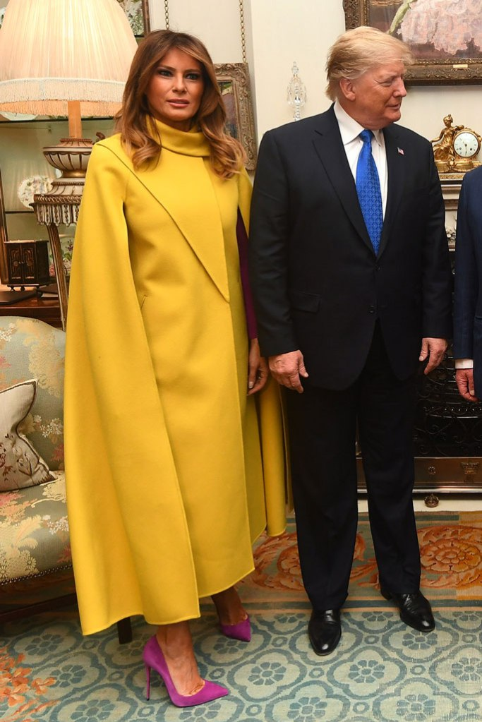 Melania Trump, cape dress, yellow dress, celebrity style, purple pumps, stilettos, donald trump, buckingham palace, London, december 2019