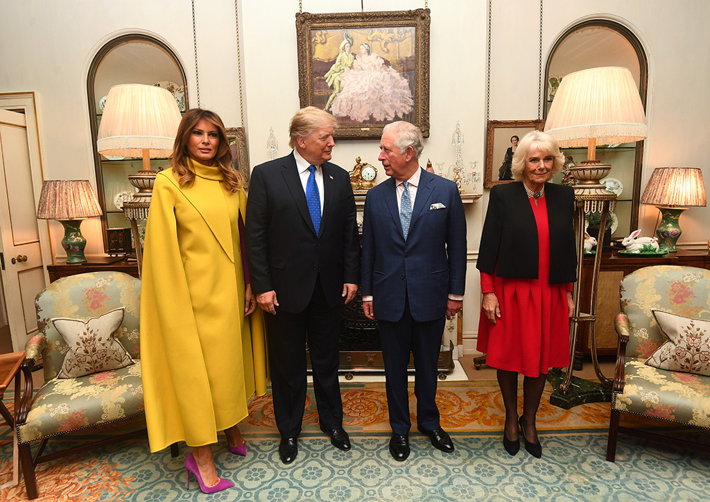melania trump, yellow cape dress, celebrity style, purple pumps, stiletto, celebrity style, camilla parker bowles, donald trump, prince charles, The Prince of Wales and the Duchess of Cornwall meets US President Donald Trump and Wife Melania at Clarence House, London, UK, on the 3rd December 2019. 03 Dec 2019 Pictured: The Prince of Wales and the Duchess of Cornwall meets US President Donald Trump and Wife Melania at Clarence House, London, UK, on the 3rd December 2019. Photo credit: James Whatling / MEGA TheMegaAgency.com +1 888 505 6342 (Mega Agency TagID: MEGA560634_004.jpg) [Photo via Mega Agency]The Prince of Wales and the Duchess of Cornwall meets US President Donald Trump and Wife Melania at Clarence House, London, UK, on the 3rd December 2019. 03 Dec 2019 Pictured: The Prince of Wales and the Duchess of Cornwall meets US President Donald Trump and Wife Melania at Clarence House, London, UK, on the 3rd December 2019. Photo credit: James Whatling / MEGA TheMegaAgency.com +1 888 505 6342 (Mega Agency TagID: MEGA560634_005.jpg) [Photo via Mega Agency]