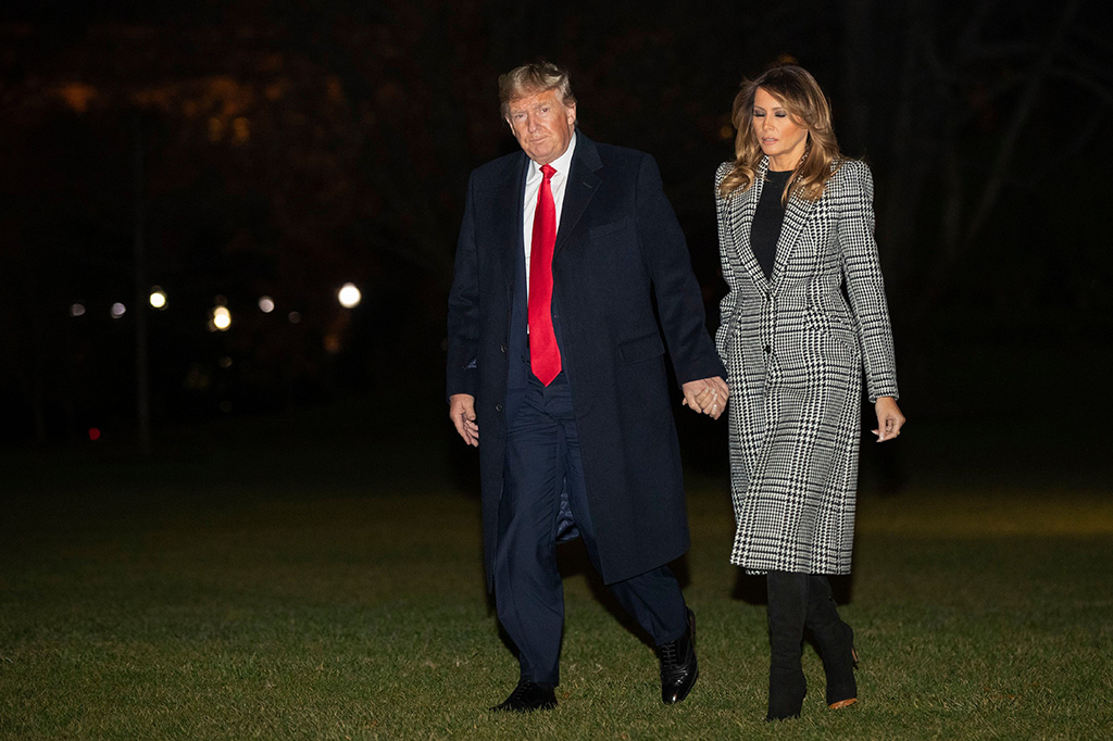 melania trump, houndstooth coat, alexander mcqueen coat, black dress, black boots, knee-high boots, air force one, Donald Trump, Melania Trump. President Donald Trump and first lady Melania Trump walk on the South Lawn of the White House, in Washington, as he returns from a NATO summit in EnglandTrump, Washington, USA - 04 Dec 2019