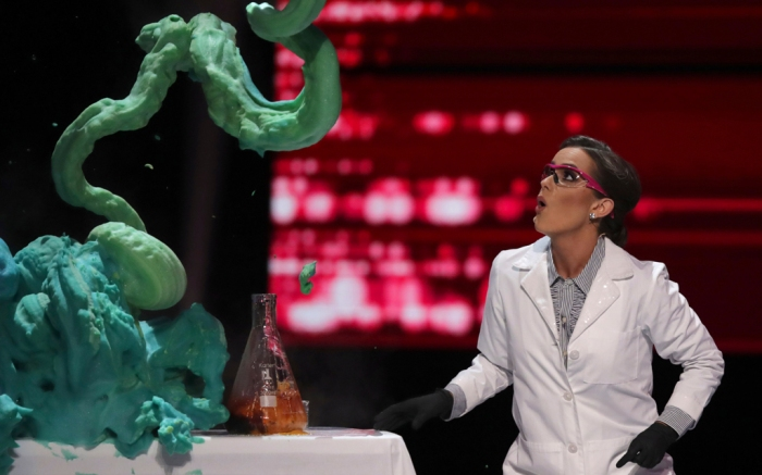 Miss America 2020, Camile Schrier, performs a science experiment on stage.