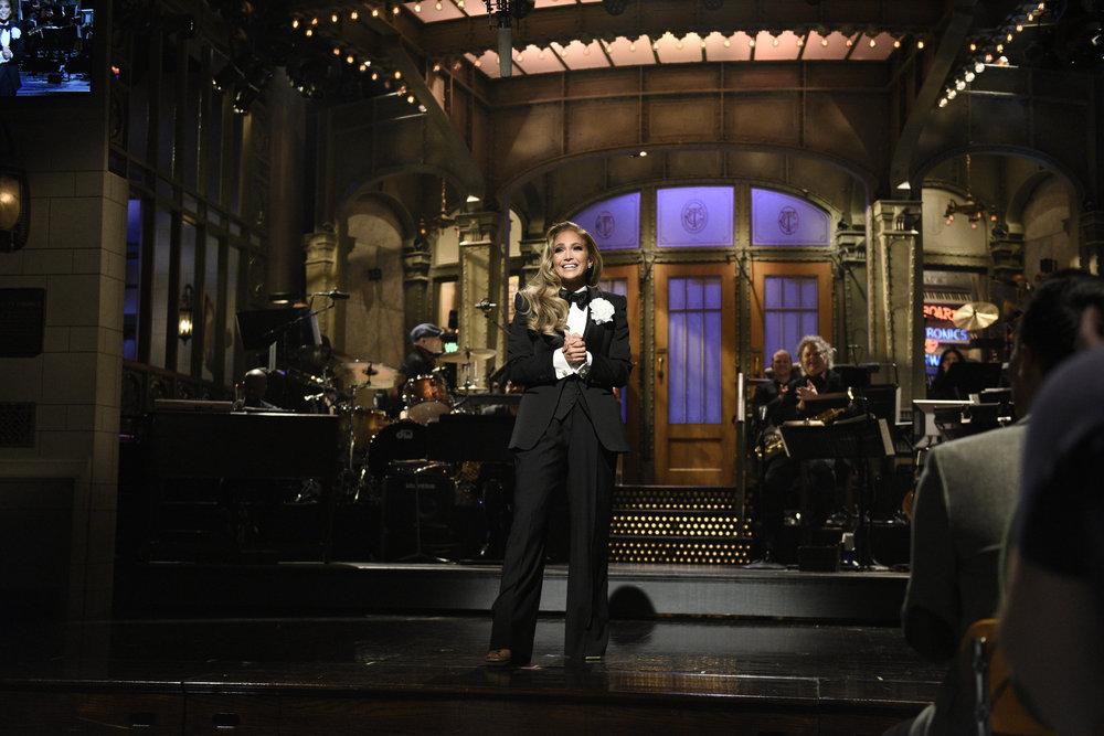 "jennifer lopez, j-lo, tuxedo, snl, monologue, SATURDAY NIGHT LIVE -- ""Jennifer Lopez"" Episode 1775 -- Pictured: Host Jennifer Lopez during the Monologue on Saturday, December 7, 2019 -- (Photo by: Will Heath/NBC)"