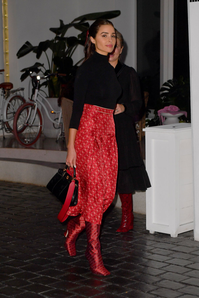 Olivia Culpo, fendi, midi skirt, boots, square toes, knee-high boots, red boots, fendi shoes, black bag, turtleneck, miami, florida, december 2019