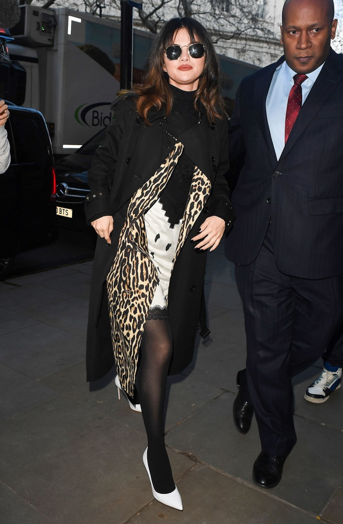 Selena Gomez, burberry, trench coat, animal print, leopard print, slip dress, dalmatian print, mindress, legs, stockings, white pumps, Selena Gomez out and about, London, UK - 11 Dec 2019
