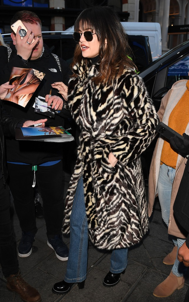 Selena Gomez, mango coat, zebra print coat, jeans, black boots, at Global HouseSelena Gomez out and about, London, UK - 11 Dec 2019Wearing Mango, High-Street Brand, Coat