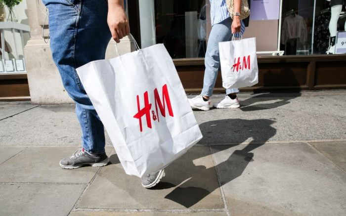 Shoppers holding a H&M shopping bag walks past a H&M Store on Oxford Street in London as UK retailers experience worst July since sales records began.Retail Sales, London, UK - 09 Aug 2019