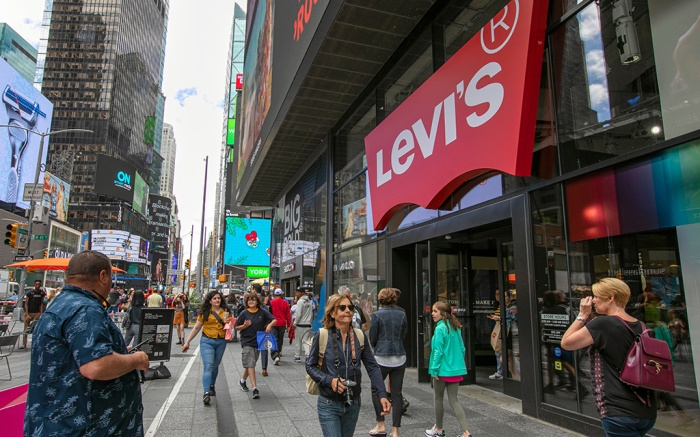 People pass the Levi's store in in New York's Times Square. Levi Strauss & Co. reports earns Tuesday, Oct. 8Earns Levi Strauss, New York, USA - 13 Jun 2019