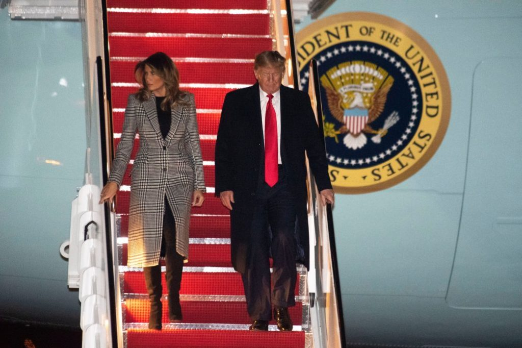 melania trump, houndstooth coat, alexander mcqueen coat, black dress, black boots, knee-high boots, air force one, President Donald Trump and first lady Melania Trump arrive on Air Force One, at Andrews Air Force Base, Md., following a trip to the NATO Summit in EnglandTrump - 04 Dec 2019