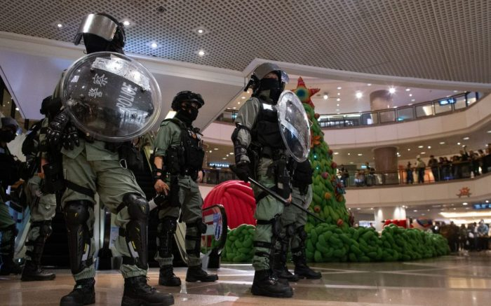 Riot police stand guard during a rally in a shopping mall in Hong Kong, China, 24 December 2019. Police fired multiple rounds of tear gas in the tourist district of Tsim Sha Tsui on Christmas eve, after clashes broke out inside a shopping mall as a large number of protesters join a 'Christmas shopping' rally. Hong Kong has entered its seventh month of mass protests, which were originally triggered by a now withdrawn extradition bill, and have since turned into a wider pro-democracy movement.Protesters and police clash on Christmas eve in Hong Kong., China - 24 Dec 2019