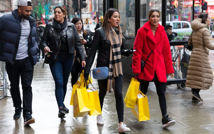 People with shopping bags walking down Oxford Street, London, Britain, 26 December 2019. Shoppers flocked to the city centre as stores slash prices in the traditional Boxing Day sales.Boxing Day sales in London, United Kingdom - 26 Dec 2019