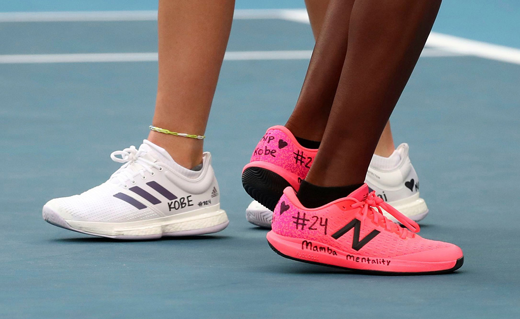 United States' Coco Gauff, right, and compatriot Caty McNally wear a tribute to Kobe Bryant on their shoes during their doubles match against Japan's Shuko Aoyama amd Ena Shibahara at the Australian Open tennis championship in Melbourne, AustraliaAustralian Open Tennis, Melbourne, Australia - 27 Jan 2020