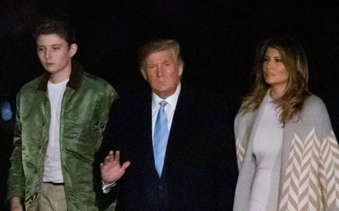 Barron Trump, Donald Trump and Melania Trump.