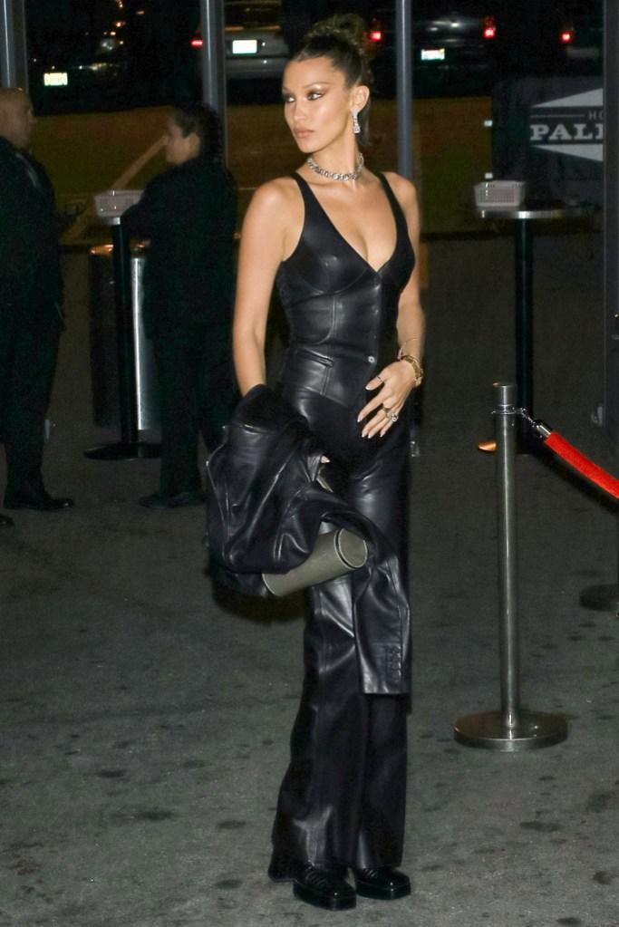 Bella Hadid, leather, vest, jacket, pants, leather pants, low-cut shirt, cleavage, choker, earrings, updo, square toe trend, art of elysium gala, celebrity style